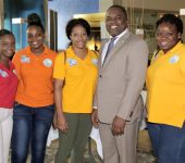 Deputy Chief Secretary and Secretary of Finance and the Economy-Joel Jack with YES summer interns at the Youth Energised for Success-Community Career Fair Lowlands edition on Friday August 18th, 2017